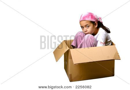 Young Girl In Box Appearing Sad