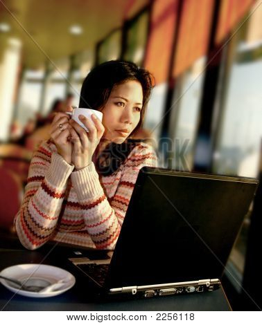 Woman Staring Out Of Aiport Cafe Window