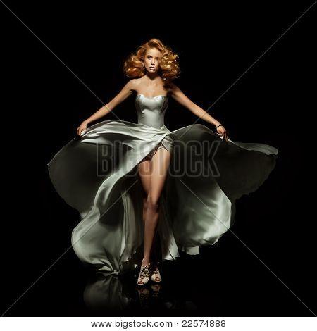 Cute blond woman in gorgeous dress