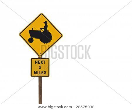 Farm tractor caution sign isolated on white..