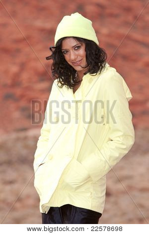 Casual young woman in raincoat