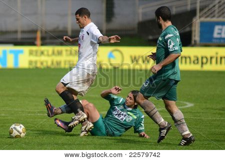 KAPOSVAR, HUNGARY - JULY 30: Andre Alves (in white) in action at a Hungarian National Championship soccer game - Kaposvar (green) vs Videoton (white) on July 30, 2011 in Kaposvar, Hungary.