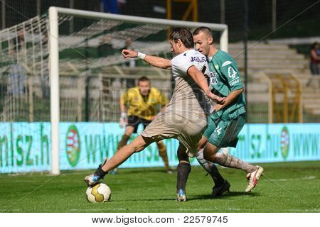 KAPOSVAR, HUNGARY - JULY 30: Dusan Vasiljevic (in white) in action at a Hungarian National Championship soccer game - Kaposvar (green) vs Videoton (white) on July 30, 2011 in Kaposvar, Hungary.