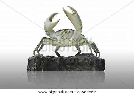 crab statue on mud