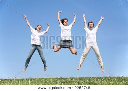 Three Girlfriends Jump Having Waved Hands