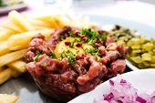 tasty Steak tartare (Raw beef) - classic steak tartare on white plate poster