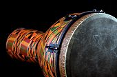picture of drums  - An orange African or Latin Djembe conga drum isolated on black background in the horizontal format with copy space - JPG