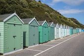 A Row Of Classic Beach Huts On Bournemouth Seafront In Dorset, Uk. poster