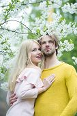 Couple In Love In Blossoming Flower, Spring. Man And Woman In Spring, Easter. Sensual Woman And Man  poster