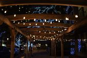Outdoor Outside Seating Eating Area Terrace Patio Pavilion Illuminated With Strands Of Lights Overhe poster