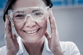 Positive Attitude To Work. Close Up Portrait Of A Cheerful Female Researcher Grinning Broadly While  poster