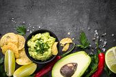 Traditional Latinamerican Mexican Sauce Guacamole Chips And Ingredients On Black Stone Background. T poster