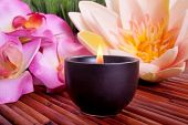 Spa candle and colorful flower for aromatherapy meditation