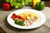Grilled Chicken With Slices, With Vegetables, Bulgur On A White Plate, Decorated With Parsley. In Th poster