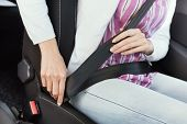 A Woman Fastens Her Seat Belt, She Wants To Travel Safely, She Knows That Her Life Is The Most Impor poster