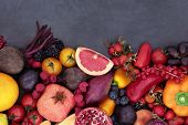 Healthy eating super food background border with fruit and vegetables high in anthocyanins, antioxid poster