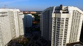 Aerial View On Apartment Building Or Apartment Building With Sun Reflection. Clip. Big White Modern  poster