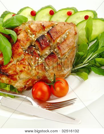 Glazed Roast Pork with vegetables isolated on white background.