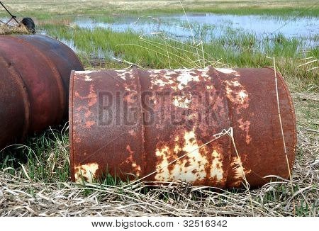 Old rusty barrels polluting the environment.