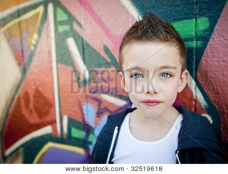 Young Boy Against Graffiti Wall