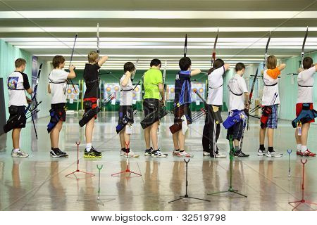 MOSCOW - APRIL 2: Backs of archers at Traditional Archery Championship among adults (undergraduate and graduate) of Russian Institute of Physical Education, on April 2, 2011 in Moscow, Russia.