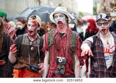 MOSCOW - MAY 14: Three unidentified participants vampires at Zombie Walk on Old Arbat, May 14, 2011, Moscow, Russia.