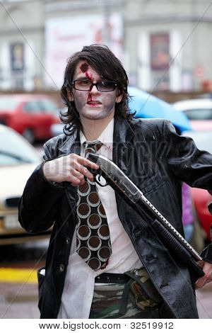 MOSCOW - MAY 14: Unidentified made-up participant of Zombie Parade on Old Arbat with shotgun in his hands, May 14, 2011, Moscow, Russia.