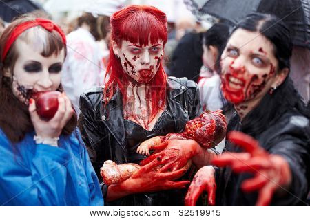 MOSCOW - MAY 14: Three unidentified made-up female participants with bloody faces and hands at Zombie Walk on Old Arbat, May 14, 2011, Moscow, Russia.