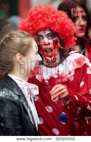 MOSCOW - MAY 14: Unidentified participants - red-haired curly dreadful clown and laughing made-up girl - at Zombie Parade on Old Arbat, May 14, 2011, Moscow, Russia.