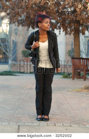 Businesswoman At Bus Stop