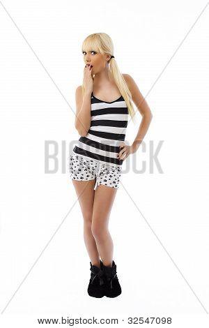 Beautiful Blonde Girl Standing In Pajamas Surprised