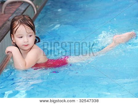 Girl swimming in a pool.