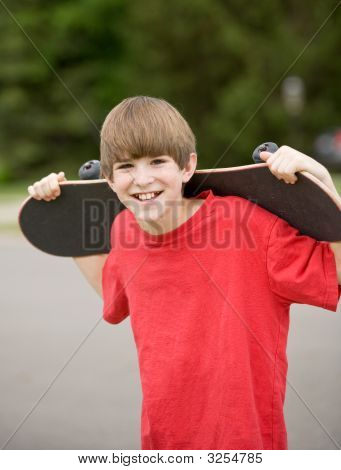 Boy Holding His Skateboard