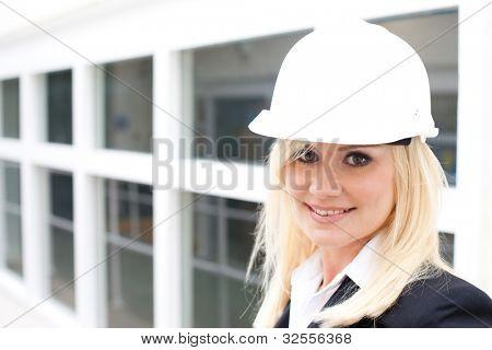 Portrait of attractive woman with construction helmet - copyspace