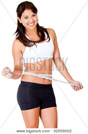 Fit woman loosing weight - isolated over a white background