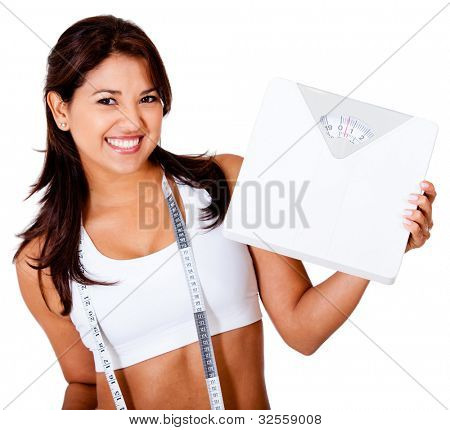 Thin woman loosing weight and holding a scale - isolated over white