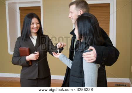 Realtor Giving Key To Couple