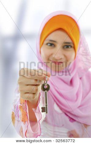 Muslim woman holding a new key