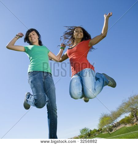 Happy Teens Jump In Air