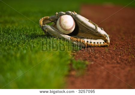 Baseball In Glove On The Field