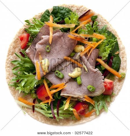 Roast beef and salad wrap with mustard, isolated on white.  Delicious, healthy eating.