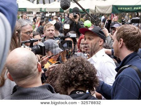 NEW YORK - MAY 1: Rage Against The Machine guitarist Tom Morello speaks to the media about the Occupy Guitarmy effort during May Day protests in Bryant Park on May 1, 2012 in New York, NY.