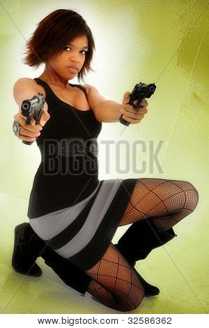 Young Adult Black Woman Defending Self with Guns Exercising Stand Your Ground Gun Law