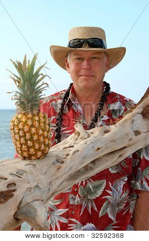 Hawaii tourist in straw hat, with pineapple