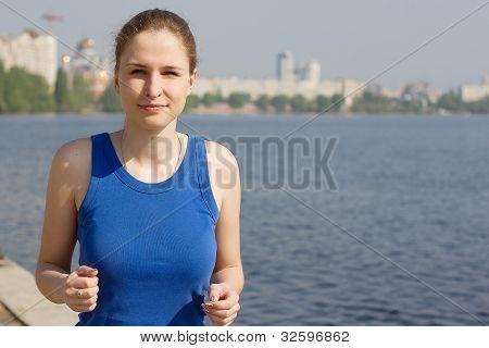 runners - woman running outdoors