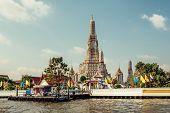 Wat Arun Ratchawararam Ratchawaramahawihan or Wat Arun buddhist temple in Bangkok, Thailand poster