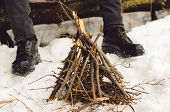 A Man Makes A Campfire In The Winter In A Hike. Concept Hike, Walk, Trip In Winter poster