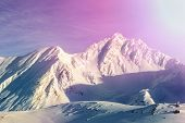 Dramatic Scenic Pink To Purple Sunrise In Austrian Alpine Mountain Peaks Covered With Snow Layer In  poster