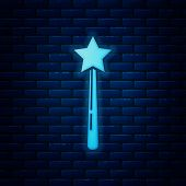 Glowing Neon Magic Wand Icon Isolated On Brick Wall Background. Star Shape Magic Accessory. Magical  poster