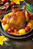 Thanksgiving Day Food. Christmas Or Thanksgiving Turkey, Baked Harvest Vegetables On Rustic Wooden T poster
